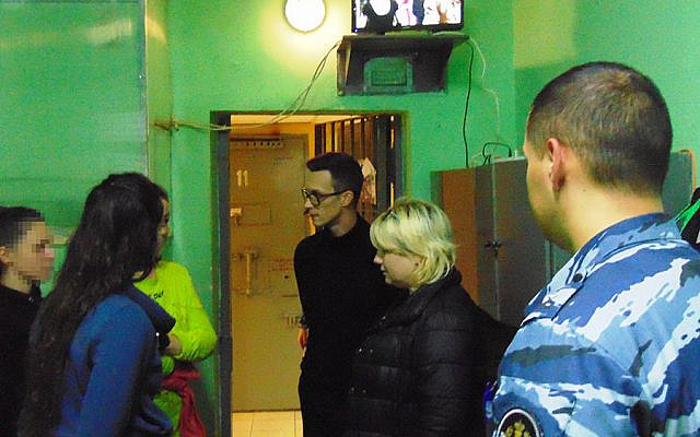 Jailed Israeli backpacker Naama Issachar (L) meets Daniil Lomakin(R), a member of the Public Observation Commission of the Moscow Region at the Novo Grishino prison, outside Moscow, on October 23, 2019. (FSIN)
