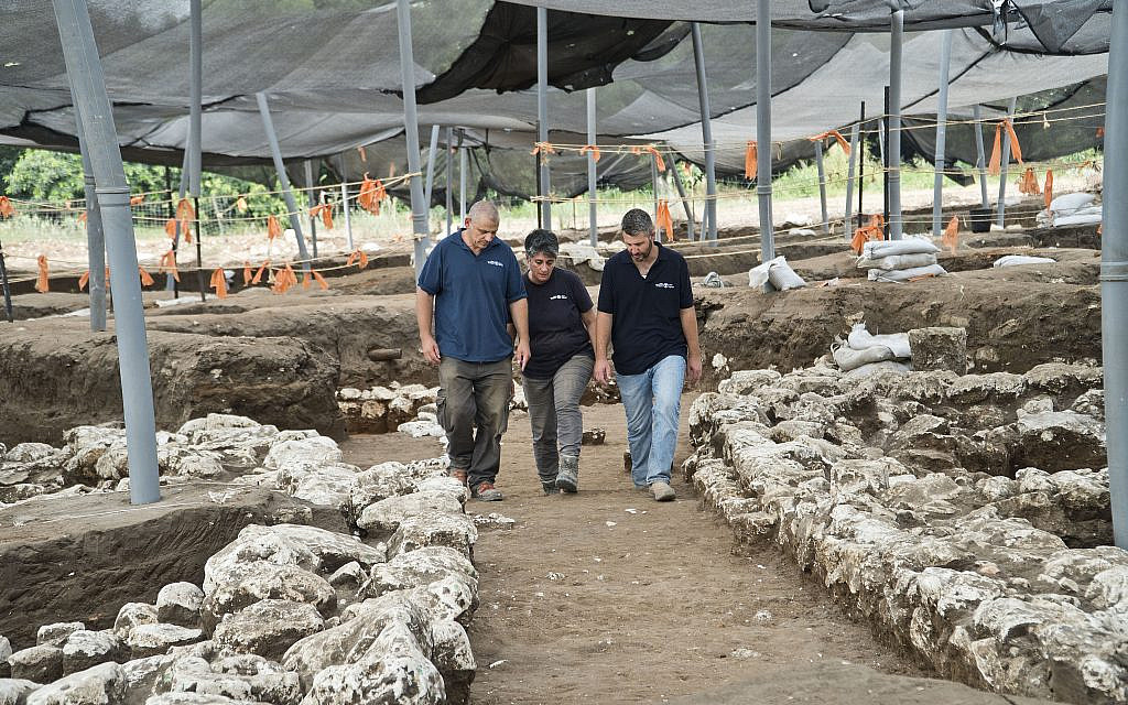 Excavation directors (left to right) Itai Elad, Dr. Dina Shalem, and Dr. Yitzhak Paz, walk in a 5,000-year-old alley at the Early Bronze Age excavation site near modern Harish. (Yoli Schwartz, Israel Antiquities Authority)