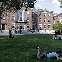 In this Wednesday, Sept. 25, 2019 photo people rest on grass while reading at Brown University, in Providence, Rhode Island (AP Photo/Steven Senne)