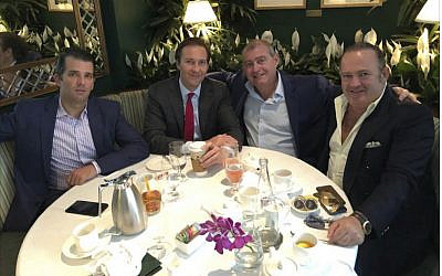 This Facebook screenshot provided by The Campaign Legal Center, shows from left, Donald Trump, Jr., Tommy Hicks, Jr., Lev Parnas and Igor Fruman, posted on May 21, 2018. (The Campaign Legal Center via AP)