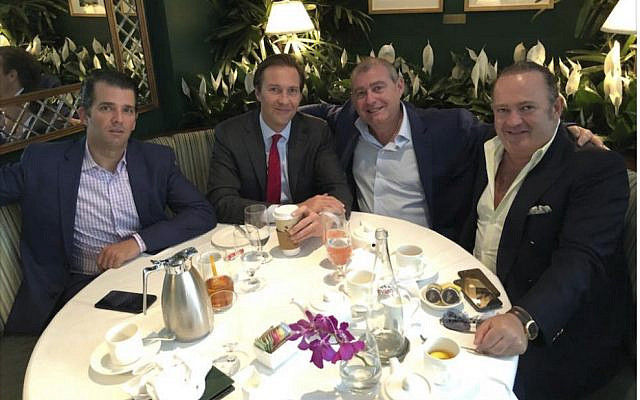 This Facebook screen shot provided by The Campaign Legal Center, shows from left, Donald Trump, Jr., Tommy Hicks, Jr., Lev Parnas and Igor Fruman, posted on May 21, 2018. (The Campaign Legal Center via AP)