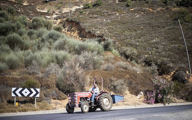 A Druze farmer drives his tractor in the Golan Heights near the border with Syria, Sept. 10 2019. (Ariel Schalit/AP)