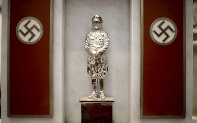 A statue of German Nazi leader Adolf Hitler discovered by police in 2017 is displayed during a press conference at the Holocaust museum in Buenos Aires, Argentina, October 2, 2019. (Natacha Pisarenko/AP)