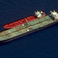 This satellite image made available October 3, 2019, shows two Iranian-flagged tankers, the Adrian Darya 1 and the Jasmine, with mooring lines tethering the two tankers together and a deployed crane on the starboard side of the Adrian Darya 1 off the coast of Syria. (Maxar Technologies via AP)