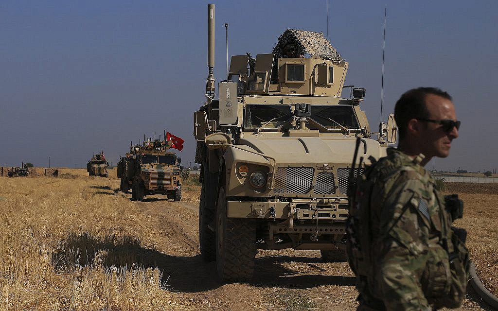 "Turkish and American armored vehicles patrol in the so-called ""safe zone"" on the Syrian side of the border with Turkey, near the town of Tal Abyad, northeastern Syria, October 4, 2019. (AP Photo/Baderkhan Ahmad)"