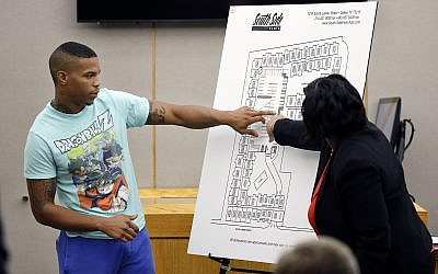n this Tuesday, Sept. 24, 2019, photo, victim Botham Jean's neighbor Joshua Brown, left, answers questions from Assistant District Attorney LaQuita Long, right, while pointing to a map of the South Side Flats where he lives, while testifying during the murder trial of former Dallas Police Officer Amber Guyger, in Dallas. Authorities say that Brown was killed in a shooting Friday, Oct. 4. (Tom Fox/The Dallas Morning News via AP, Pool)