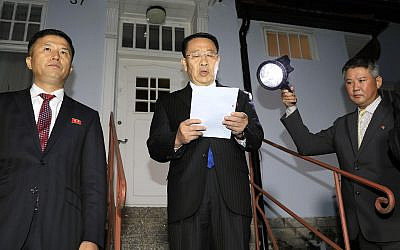 North Korean negotiator Kim Miyong Gil, center, reads statement outside the North Korean Embassy in Stockholm, Sweden, Oct. 5, 2019 (Kyodo News via AP)