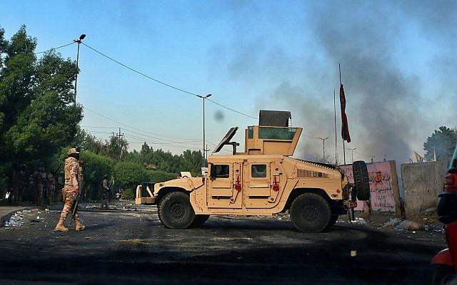 Iraqi Army troops deploy at a site of protests in Baghdad, Iraq on October. 6, 2019. (AP/ Khalid Mohammed)