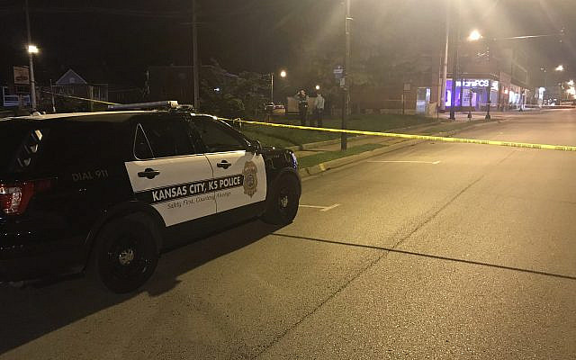 In this image from 41 KSHB Kansas City Action News police work the scene of a shooting outside a Kansas City, Kansas bar on October 6, 2019. (41 KSHB Kansas City Action News via AP)
