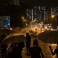 Protestors face police tear gas in Hong Kong, October 6, 2019. (AP Photo/Felipe Dana)