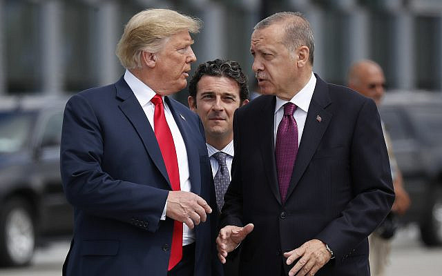 In this photo from July 11, 2018, US President Donald Trump, left, talks with Turkey's President Recep Tayyip Erdogan, as they arrive together for a family photo at a summit of heads of state and government at NATO headquarters in Brussels. (AP Photo/Pablo Martinez Monsivais, File)