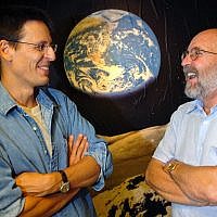 "In this Thursday, Aug. 11, 2005 file photo Swiss Astronomers Michel Mayor, right, and Didier Queloz, left, pose for the photographer at the Astronomical Observatory of the University of Geneva. The 2019 Nobel prize in Physics was given to James Peebles ""for theoretical discoveries in physical cosmology,"" and the other half jointly to Michel Mayor and Didier Queloz ""for the discovery of an exoplanet orbiting a solar-type star,"" said Prof. Goran Hansson, secretary-general of the Royal Swedish Academy of Sciences that chooses the laureates. (Laurent Gillieron, Keystone via AP)"