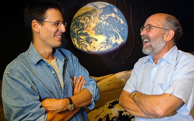 """In this Thursday, Aug. 11, 2005 file photo Swiss Astronomers Michel Mayor, right, and Didier Queloz, left, pose for the photographer at the Astronomical Observatory of the University of Geneva. The 2019 Nobel prize in Physics was given to James Peebles """"for theoretical discoveries in physical cosmology,"""" and the other half jointly to Michel Mayor and Didier Queloz """"for the discovery of an exoplanet orbiting a solar-type star,"""" said Prof. Goran Hansson, secretary-general of the Royal Swedish Academy of Sciences that chooses the laureates. (Laurent Gillieron, Keystone via AP)"""