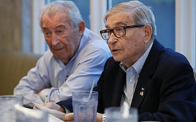 David Mermelstein, right, president of Miami-Dade Holocaust Survivors (and Vice President of the Holocaust Survivors Foundation USA (HSF), speaks during an interview with The Associated Press, on October 7, 2019. (AP Photo/Wilfredo Lee)