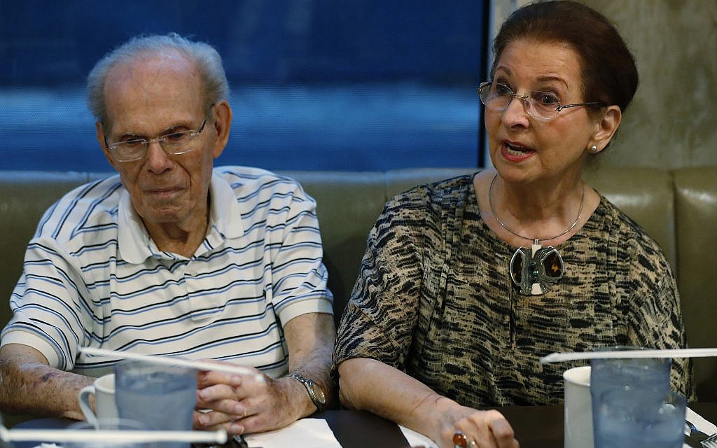 In this, Monday, Oct. 7, 2019 photo, Vera Karliner, right, speaks during an interview with The Associated Press in Aventura, Fla., along with her husband Herb, left, who was on the ship named the St. Louis that was full of Jewish refugees but was turned away from the U.S. in 1939. Aging Holocaust survivors are trying to recover insurance benefits that were never honored by Nazi-era companies, which could be worth billions of dollars. (AP Photo/Wilfredo Lee)