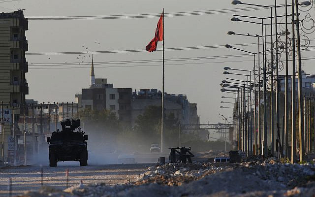 A Turkish police armored vehicle patrols the town of Akcakale, Sanliurfa province, southeastern Turkey, at the border with Syria on October 12, 2019. (AP/Lefteris Pitarakis)