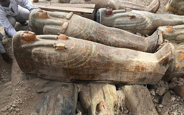 This photo provided by the Egyptian Ministry of Antiquities shows recently discovered ancient colored coffins with inscriptions and paintings, in the southern city of Luxor, Egypt, October 15, 2019. (Egyptian Ministry of Antiquities via AP)
