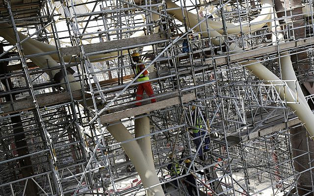 In this Oct. 8, 2019, photo, laborers work on the Al Wasl Dome at the under construction site of the Expo 2020 in Dubai, United Arab Emirates.  (AP Photo/Kamran Jebreili)