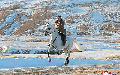In this undated photo provided on October 16, 2019, by the North Korean government, North Korean leader Kim Jong Un rides a white horse to climb Mount Paektu, North Korea. (Korean Central News Agency/Korea News Service via AP)