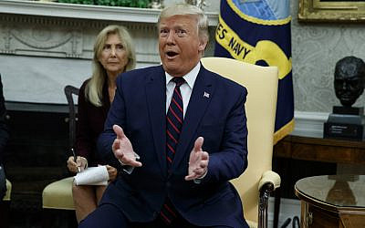 US President Donald Trump speaks during a meeting with Italian President Sergio Mattarella in the Oval Office of the White House, October 15, 2019, in Washington. (AP Photo/Evan Vucci)