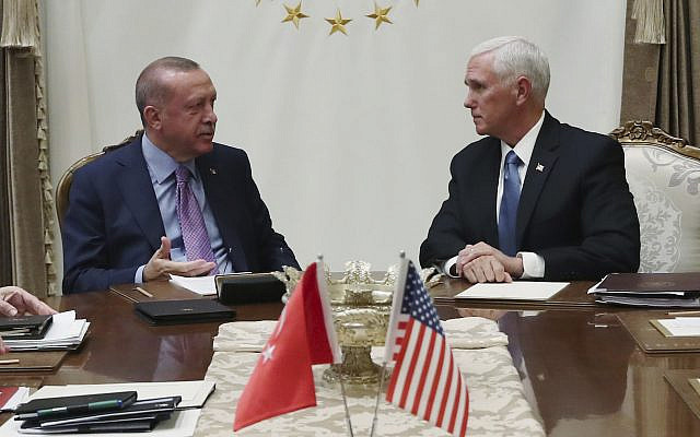 Turkey's President Recep Tayyip Erdogan, left, talks with US Vice President Mike Pence, during their meeting at the Presidential Palace in Ankara, Turkey, October 17, 2019. (Presidential Press Service via AP, Pool)