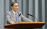 Japan's Chief Cabinet Secretary Yoshihide Suga speaks during a press conference at the prime minister's official residence in Tokyo, October 18, 2019. (Toshiyuki Matsumoto/Kyodo News via AP)