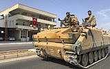 Turkish-backed Syrian opposition fighters ride atop their armored personnel carrier to cross the border into Syria, in Akcakale, Sanliurfa province, southeastern Turkey, October 18, 2019 (AP Photo/Mehmet Guzel)