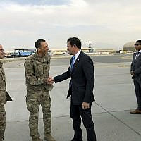 US Defense Secretary Mark Esper, center, is greeted by U.S. military personnel upon arriving in Kabul, Afghanistan, Sunday, Oct. 20, 2019.  (AP Photo/Lolita C. Balbor)