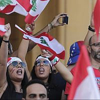 Anti-government protesters shout slogans against the Lebanese government during a protest in Beirut, Lebanon, October 21, 2019. (AP Photo/Hassan Ammar)