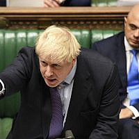 Britain's Prime Minister Boris Johnson speaks in the House of Commons in London during the debate for the EU Withdrawal Agreement Bill, on Oct. 22, 2019. (Jessica Taylor, UK Parliament via AP)