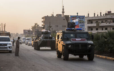 Russian forces patrol in the city of Amuda, north Syria, Thursday, Oct. 24, 2019. Syrian forces, Russian military advisers and military police are being deployed in a zone 30 kilometers (19 miles) deep along much of the northeastern border, under an agreement reached Tuesday by Russia and Turkey. (AP Photo/Baderkhan Ahmad)