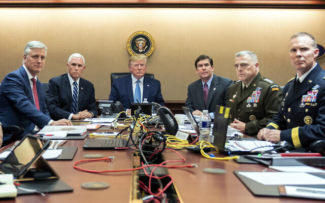In this photo provided by the White House, US President Donald Trump is joined by from left, national security adviser Robert O'Brien, Vice President Mike Pence, Defense Secretary mark Esper, Joint Chiefs Chairman Gen. Mark Milley and Brig. Gen. Marcus Evans, Deputy Director for Special Operations on the Joint Staff, October 26, 2019, in the Situation Room of the White House in Washington. (Shealah Craighead/The White House via AP)