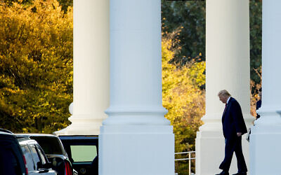US President Donald Trump walks out of the North Portico of the White House in Washington, Monday, Oct. 28, 2019, to travel to Andrews Air Force Base, Md., and then on to Chicago. (AP Photo/Andrew Harnik)