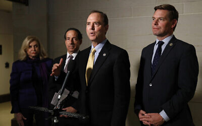 Rep. Adam Schiff, D-California, center, speaks with members of the media after former deputy national security adviser Charles Kupperman signaled that he would not appear as scheduled for a closed door meeting to testify as part of the House impeachment inquiry into US President Donald Trump, on Capitol Hill in Washington, October 28, 2019. (Patrick Semansky/AP)