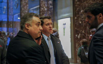 In this December 12, 2016 photo, Los Angeles venture capitalist Imaad Zuberi, left, arrives at Trump Tower in New York. (AP Photo/Kathy Willens)