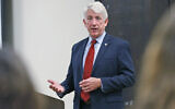 Virginia Attorney General Mark Herring talks with University of Richmond students at the school in Richmond, Virginia, October 4, 2017. (AP Photo/Steve Helber)