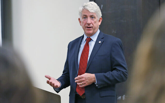 Virginia Attorney General Mark Herring talks with University of Richmond students at the school in Richmond, Virginia, October 4, 2017. (AP Photo/Steve Helber)