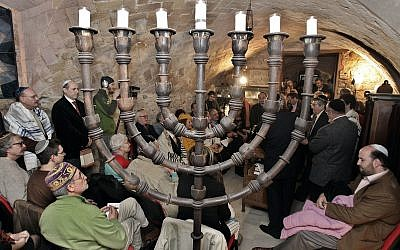Illustrative: Members of the the restored Synagogue of Barcelona assist at the welcoming of a new torah in Barcelona, Spain, Sunday, January 22, 2006. (AP/Manu Fernandez)
