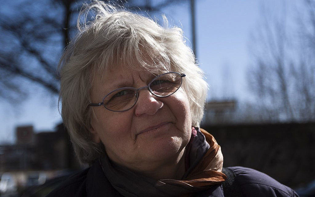 German 'Graffiti Grandma' fined on Yom Kippur for painting over neo-Nazi slogans