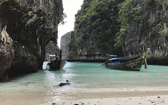 Illustrative -- In this Dec. 5, 2016 photo, long-tail boats sit near a small beach on Ko Phi Phi Leh, an island off the southwestern coast of Thailand (AP Photo/Courtney Bonnell)