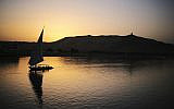 A pleasure boat carrying tourists and locals sails in the Nile River at sunset in Aswan, Egypt, April 29, 2015. (AP Photo/Mosa'ab Elshamy, File)