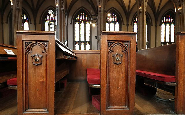 This May 2, 2018 photo shows empty pews inside the historic Trinity Church in New York.  (AP Photo/Kathy Willens)