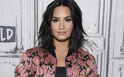 "In this March 20, 2017 file photo, Demi Lovato participates in the BUILD Speaker Series to discuss ""Smurfs: The Lost Village"" in New York.  (Photo by Charles Sykes/Invision/AP)"