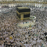 Muslim pilgrims perform the tawaf-e-ifadha circling of the Kaaba, during the annual Haj pilgrimage on the first day of Eid al-Adha in Mecca, Saudi Arabia, August 21, 2018. (AP Photo/Dar Yasin)