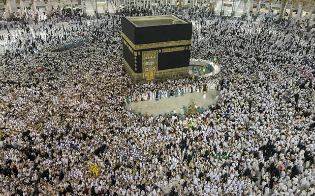 Muslim pilgrims perform the tawaf-e-ifadha circling of the Kaaba, during the annual Haj pilgrimage on the first day of Eid al-Adha in Mecca, Saudi Arabia, Tuesday, Aug. 21, 2018. The five-day pilgrimage represents one of the five pillars of Islam and is required of all able-bodied Muslims once in their life. (AP Photo/Dar Yasin)