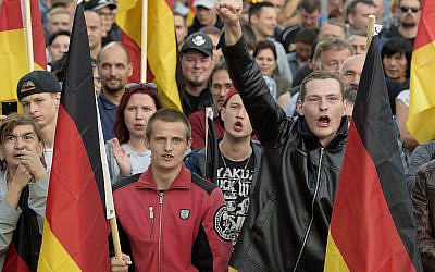 Far-right groups protest in Chemnitz, eastern Germany, September 7, 2018, after several nationalist groups called for marches protesting the killing of a German man allegedly by migrants from Syria and Iraq. (AP Photo/Jens Meyer)