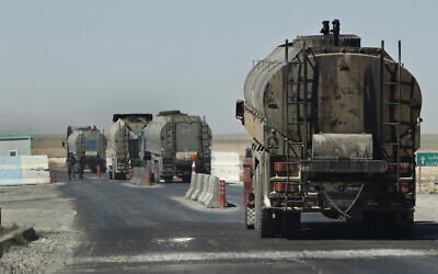 File: In this April 4, 2018 photo, a convoy of oil trucks passes a Kurdish police checkpoint as they move fuel produced in Kurdish-held areas in Syris (AP Photo/Hussein Malla)