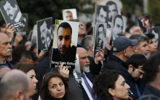 Protesters hold portraits of Armenian intellectuals during a rally held to commemorate the 104th anniversary of the 1915 mass killing of Armenians in the Ottoman Turks in Istanbul, Wednesday, April 24, 2019. (AP Photo/Lefteris Pitarakis)