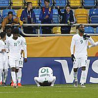 Team Saudi Arabia celebrates after Saudi Arabia's Hassan Altambakti scored his side's second goal during the Group E U20 World Cup soccer match between Saudi Arabia and Mali in Gdynia, Poland, May 28, 2019. (Darko Vojinovic/AP)
