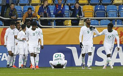 Team Saudi Arabia celebrates after Saudi Arabia's Hassan Altambakti scored his side's second goal during the Group E U20 World Cup soccer match between Saudi Arabia and Mali in Gdynia, Poland, May 28, 2019. (Darko Vojinovic/AP)
